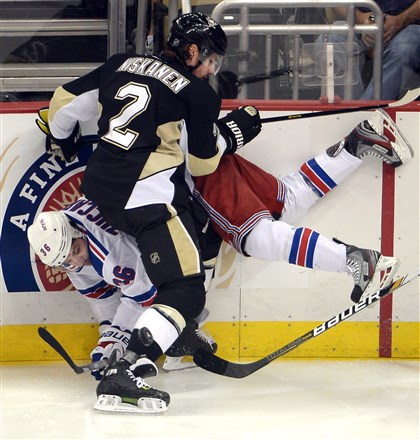 20140509mfpenssports06 Penguins' Matt Niskanen checks Rangers' Mats Zuccarello into the boards in the second period of the Eastern Conference semifinals at Consol Energy Center May 9.