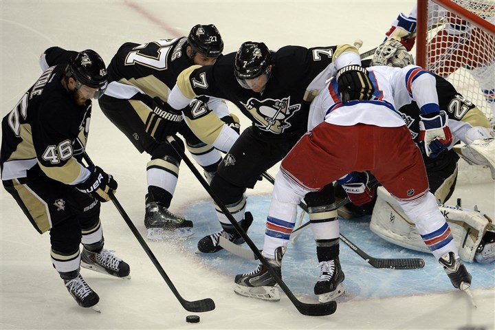 Penguins defend with Fleury vs. Rangers Joe Vitale, Craig Adams and Paul Martin help defend in front of goaltender Marc-Andre Fleury against the New York Rangers' Rick Nash in the first period of the Eastern Conference semifinals.
