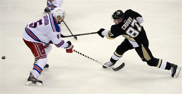 Sidney Crosby gets a shot Sidney Crosby gets a shot past Rangers' Dan Girardi in the second period at Consol Energy Center Friday night.