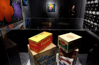 "An exhibit of Andy Warhol's paintings and objects An exhibit of Andy Warhol's paintings and objects titled simply ""Warhol."""