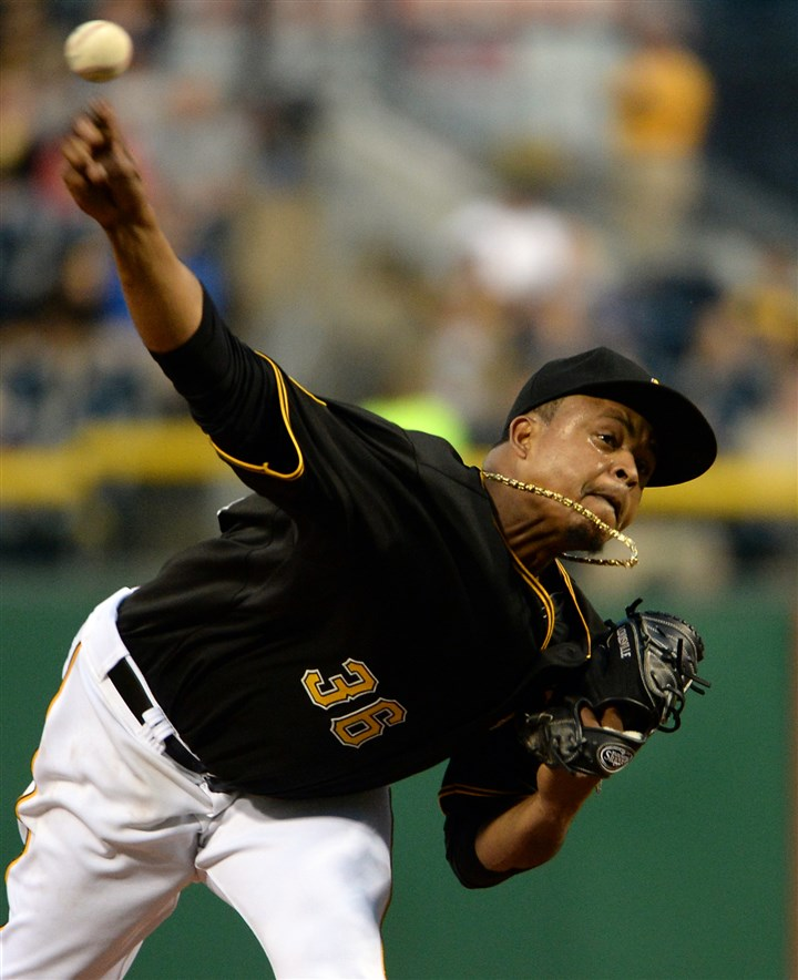 Edinson Volquez pitches against the Cardinals Edinson Volquez pitches against the Cardinals at PNC Park Saturday night.