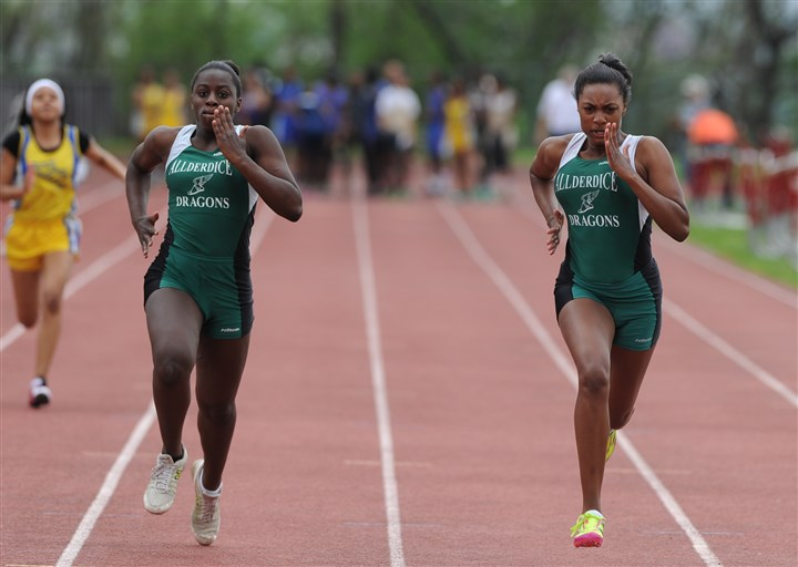 20140510lfTrackSport02-10 Allderdice's Aquia Chamber, left, and Maya Wilson complete in the 100-meter dash in the City League track championships Saturday atold Oliver High School.