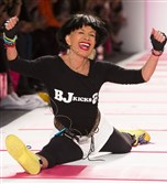 Fashion designer Betsey Johnson's runway shows are upbeat and usually end with models dancing down the runway -- and the designer doing her signature cartwheel and split.