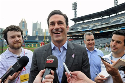 "20140511mfhammlocal01 Actor Jon Hamm talks to reporters at PNC Park Sunday about his upcoming movie ""Million Dollar Arm,"" based on the true story of the Indian pitchers signed by the Pirates."