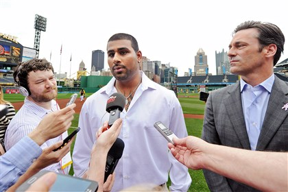 "20140511mfhammlocal02-1 Rinku Singh, center, and actor Jon Hamm talk to reporters at PNC Park Sunday about the movie ""Million Dollar Arm,"" based on the true story of the Indian pitchers signed by the Pirates."
