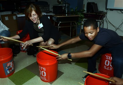 20140507bwPropelSeen04 Melissa Doyle bucket-drums with Jeremiah Fielder,12, a 6th grader from Propel North Side.