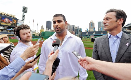 "20140511mfhammlocal02-1 Rinku Singh and actor Jon Hamm talk to reporters at PNC Park Sunday about the movie ""Million Dollar Arm,"" based on the true story of the Indian pitchers signed by the Pirates."