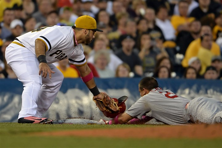 20140511mfbucssports04-2 The Cardinals' Allen Craig slides safely into third base against the Pirates' Pedro Alvarez in the first inning Sunday night at PNC Park.