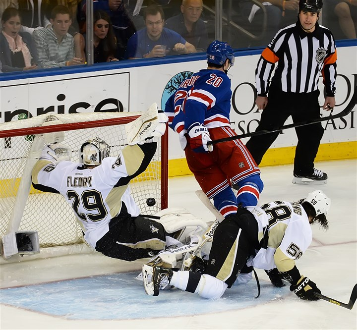 20140511pdPenguinsSports07-4 Penguins' goaltender Marc-Andre Fleury falls after colliding with Chris Kreider of the New York Rangers at Madison Square Garden in New York.