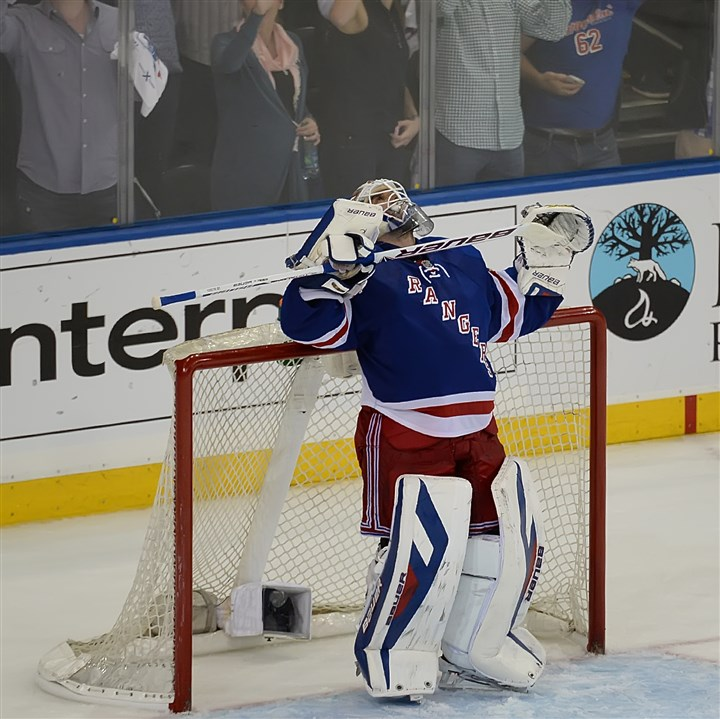 lundqvist0512 Rangers goalie Henrik Lundqvist celebrates after beating the Penguins in Game 6 at Madison Square Garden Sunday night.