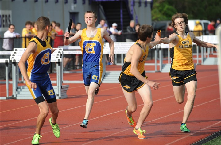 20140512jrtracksports2-1 Cody Shock hands off baton to Ethan Linderman of Cano- McMillan (left) while Nick McClure hands off to Caleb Schaelchlin of North Allegheny in the boys 3,200-meter relay at the WPIAL Class AAA and AA championships Monday at Baldwin High.