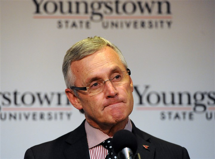 20140512JHLocalTressel06-4 Jim Tressel, ousted Ohio State University football coach, speaks Monday at a news conference after being named ninth president of Youngstown State University.