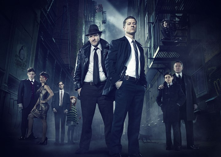 "20140513HOGotham ""Gotham"" traces the rise of the great DC Comics super-villains and vigilantes. From left, Robin Lord Taylor, Jada Pinkett Smith, guest star Cory Michael Smith, guest star Clare Foley, Donal Logue, Ben McKenzie, Camren Bicondova (on catwalk), David Mazouz and Sean Pertwee."