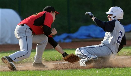hsbase2 North Catholic third baseman Nick Nyman puts the tag on Rochester's Chaz Verrico on a steal attempt.