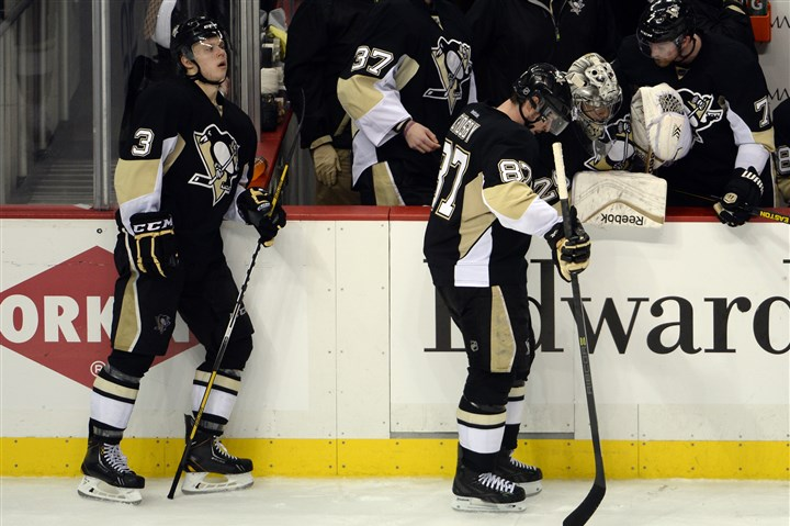 20140513mfpenssports14-1 Penguins' Olli Maatta and Sidney Crosby react after losing to the Rangers in Game 7 of the Eastern Conference semifinals at Consol Energy Center tonight.