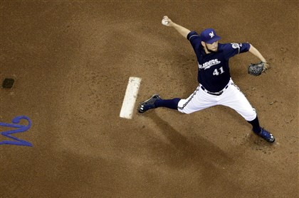 Pirates Brewers Baseball Brewers starting pitcher Marco Estrada throws during the first inning against the Pirates Tuesday night in Milwaukee.