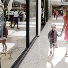 Retail Sales Anneka Johnson of Estonia walks with her son while shopping at Aventura Mall in Aventura, Fla. The Commerce Department released retail sales data for April on Tuesday.