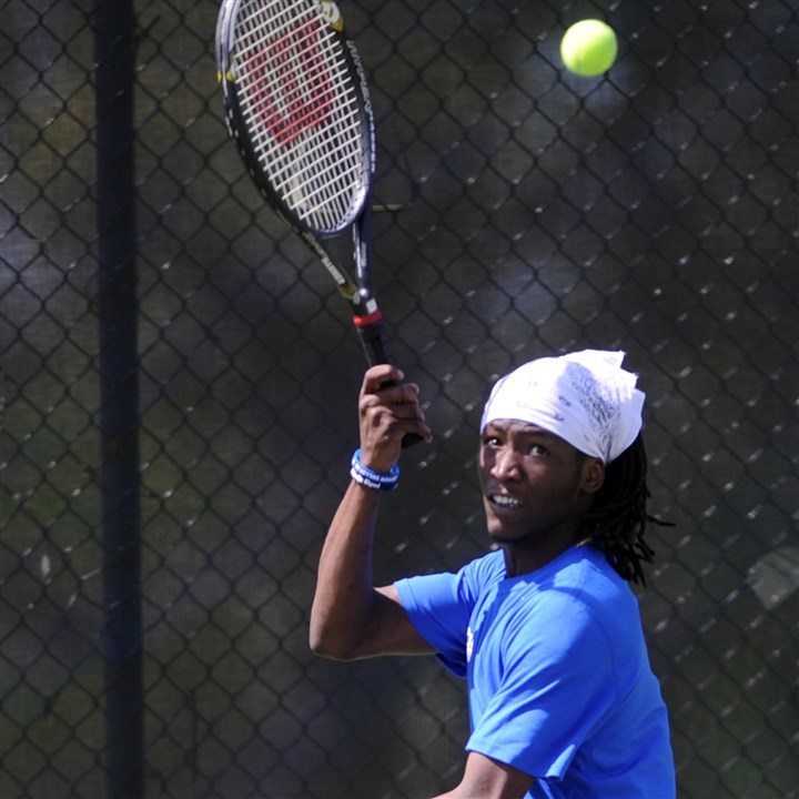 20140506ppCityTennis6ZONESPTS Keron Jones of Perry returns a volley during the City League boys tennis singles championship May 6. Jones won, 2-6, 6-2, 6-2.