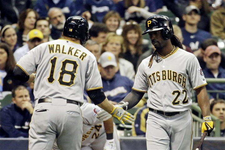 Pirates Brewers Baseball The Pirates' Neil Walker is congratulated by teammate Andrew McCutchen after Walker's home run during the first inning against the Milwaukee Brewers Tuesday night.