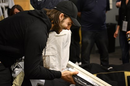 Kris Letang packs up his sticks Kris Letang packs up his sticks as he prepares to leave the Penguins locker room for the final time Thursday, May 15, 2014 at the Consol Energy Center.