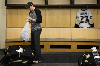 Marc-Andre Fleury packs up Marc-Andre Fleury packs up his jersey as he prepares to leave the Penguins locker room for the final time Thursday, May 15, 2014 at the Consol Energy Center.