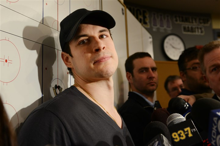 20140515jrPensSports9-2 Sidney Crosby takes questions from reporters in the locker room at Consol Energy Center.