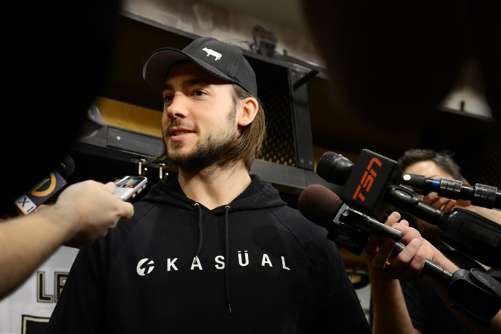 20140515jrPensSports6-1 Kris Letang takes questions from reporters in the locker room at Consol Energy Center.