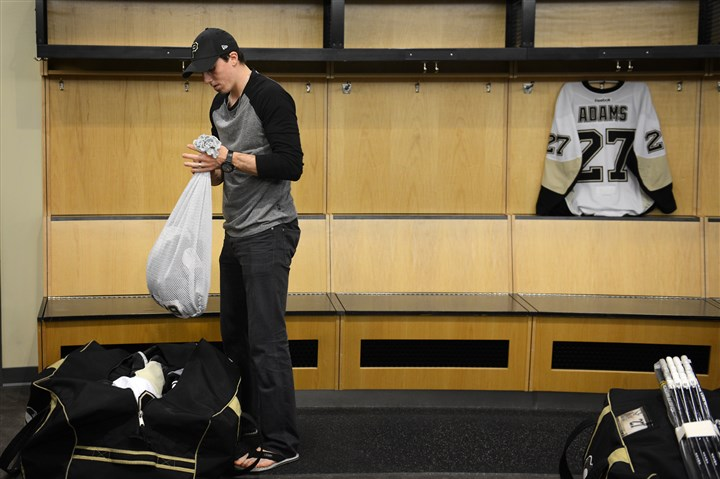 20140515jrPensSports1.1 Marc-Andre Fleury packs up his jersey as he prepares to leave the Penguins locker room for the final time at Consol Energy Center.