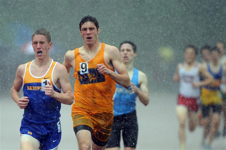 sloan0516 Hampton's Nathan Sloan leads Central Catholic's Jeff Van Kooten in a downpour during the WPIAL Boys Class AAA 1600-meter event at Baldwin. Van Kooten won the race; Sloan placed second.