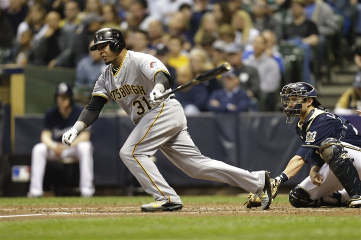 20140515bucs0515a Pirates' Jose Tabata hits a RBI single in the top of the fourth inning against the Milwaukee Brewers at Miller Park.
