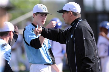 20140516JHSportsBB07-6 Seneca Valley pitcher Brandon Schlick trades a fist bump with coach Eric Semega.