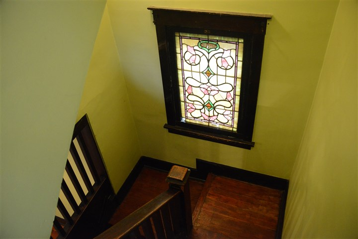 20140515lfHouseMag05-4 Front hall staircase and stained glass.