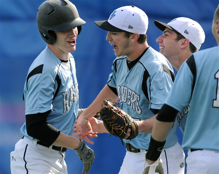 20140516JHSportsBB01 Seneca Valley John Davis, left, gets congratulated by teammates after his second inning home run against Hempfield in a AAAA playoff game May 16 in West Mifflin.