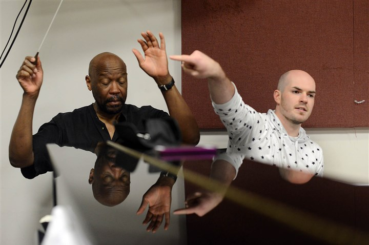 "Director and conductor of Neighborhood Opera Company Director Seamus Ricci, right, and conductor Thomas W. Douglas work through a scene during a rehearsal for the Neighborhood Opera Company's ""The Don's Fire: Mozart's Giovanni"" at Carnegie Mellon University."