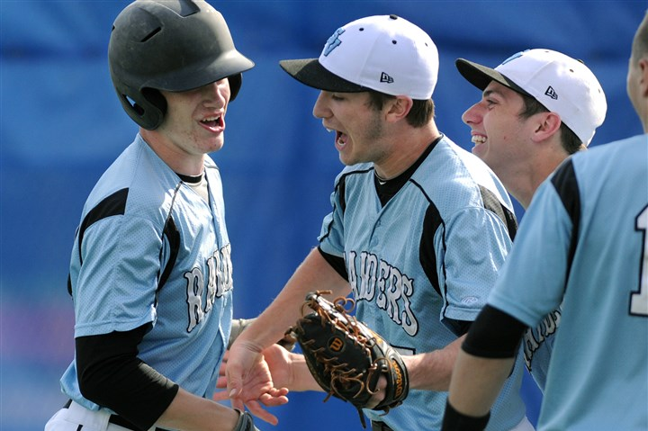 20140516JHSportsBB01 Seneca Valley's John Davis, left, is congratulated by teammates after his second-inning home run against Hempfield.