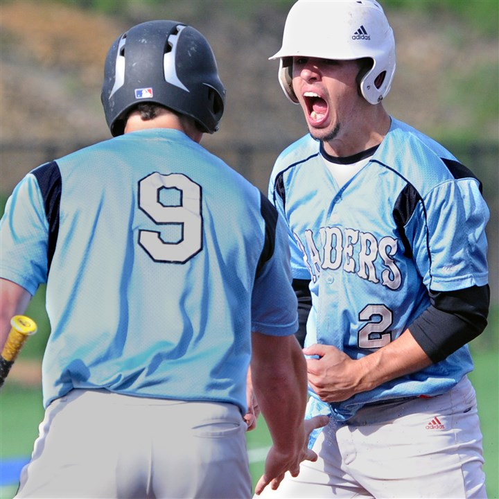 20140516JHSportsBB04-3 Seneca Valley's Matt Wagner, left, and Matt Rafferty celebrate after a four-run third inning Friday against top-seed Hempfield in a Class AAAA playoff game at West Mifflin. Seneca Valley won, 10-5.