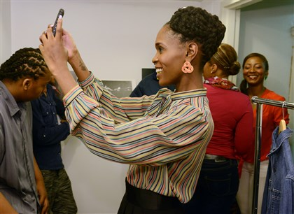 Courtney Keeton, International Natural Hair Meetup Day Courtney Keeton of Stanton Heights takes a selfie photo backstage of her hairstyle for International Natural Hair Meetup Day.