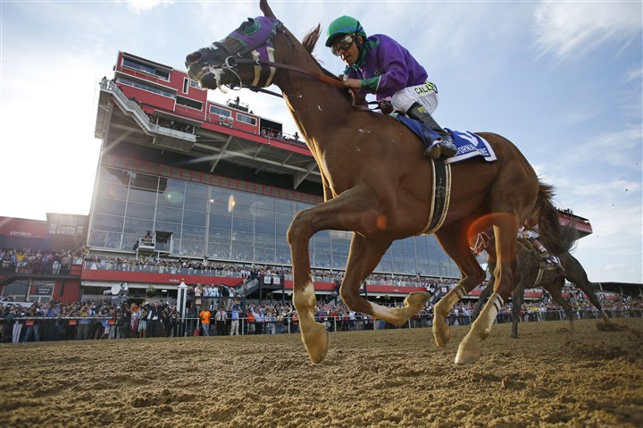Preakness Horse Racing California Chrome, ridden by jockey Victor Espinoza, wins the 139th Preakness Stakes horse race at Pimlico Race Course, Saturday, May 17, 2014, in Baltimore.