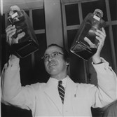 Dr. Jonas Salk with Salk polio vaccine at one of several press conferences in Pittsburgh hospital in Oakland.