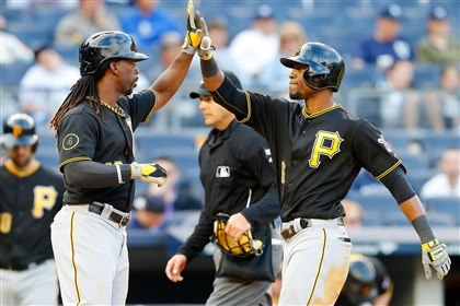 Starling Marte celebrates with Andrew McCutchen Starling Marte celebrates his sixth-inning two-run home run against the Yankees with teammate Andrew McCutchen at Yankee Stadium Sunday in the Bronx.