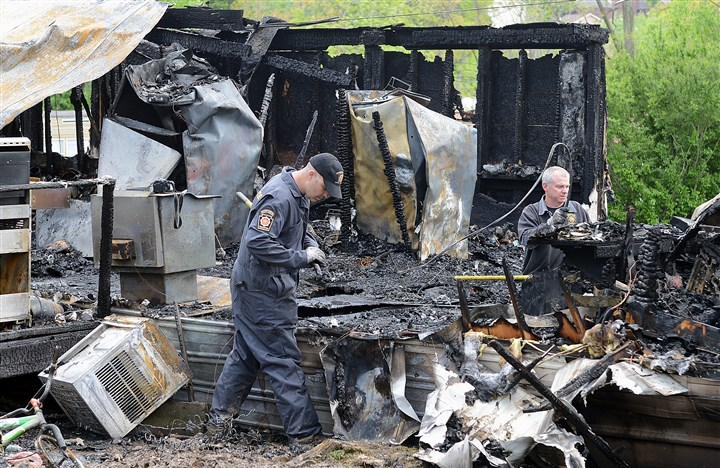 Fire in Indiana County Investigators sift through the burned ruins of a mobile home on Independence Lane in White Township, Indiana County. Three people died in the early Sunday morning fire.
