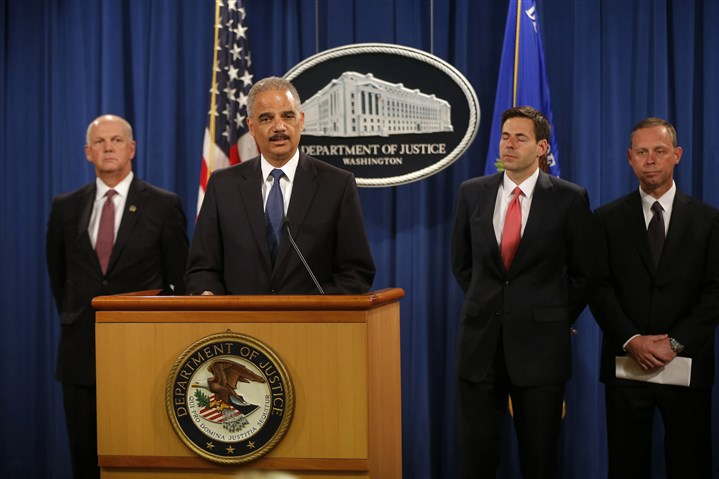 China Cyberspying Attorney General Eric Holder speaks at a news conference Monday announcing that a U.S. grand jury has charged five Chinese hackers with economic espionage and trade secret theft. Unlike the other companies targeted, Westinghouse had signed an agreement to voluntarily share all of the technology behind its new generation AP1000 reactor with its Chinese partners.