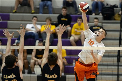 dixon0521 Bethel Park's Jacob Dixon goes for a kill against North Allegheny's Robert Stiefvater and Jeremy Best Tuesday night.