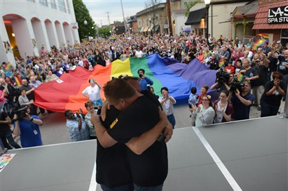 20140520MWHequalityLocal02-1 Peter Karlovich, right, proposes to his partner of 28 years Steve Herforth, left, in front of the crowd gathered on Ellsworth Avenue in Shadyside to celebrate a federal judge ruling Pennsylvania's ban on same-sex marriage unconstitutional on May 20, 2014.