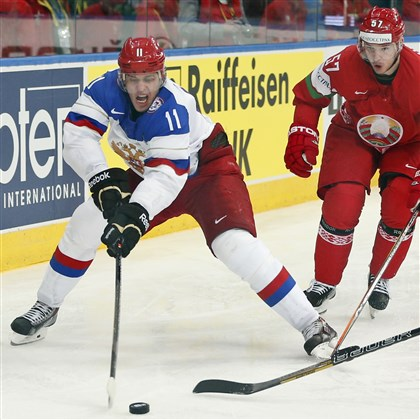 Belarus Hockey Worlds Russia forward Evgeni Malkin, left, battles for the puck with Belarus defender Ivan Usenko during the Group B preliminary round match between Russia and Belarus at the Ice Hockey World Championship in Minsk, Belarus, Tuesday, May 20, 2014.
