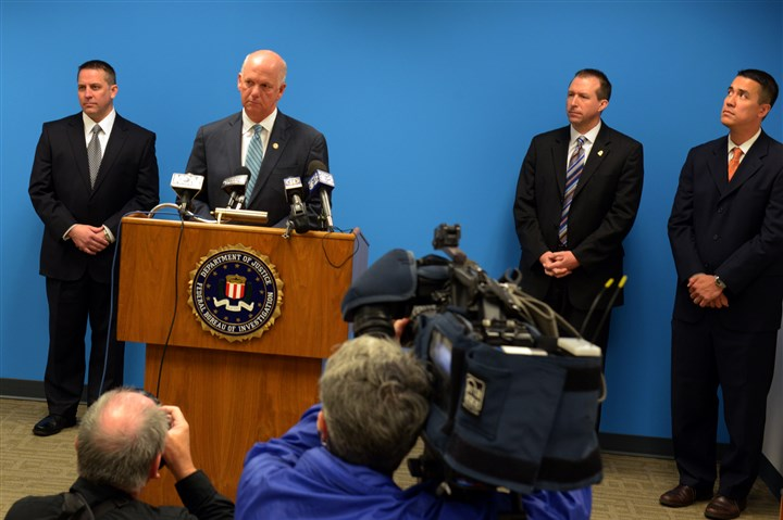 20140520ppCYBERESPIONAGE1LOCAL U.S. Attorney David Hickton answers questions from the media on the recent cyberespionage case at FBI Headquarters on the South Side.