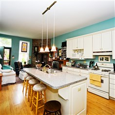 942 West North Avenue - The kitchen and sitting area 942 West North Avenue -Neighbor Mary Callison chose a more modern look, with white cabinetry and granite counter tops.