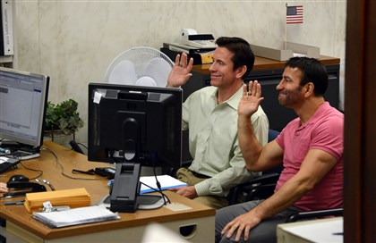 "20140521MWHlicensesLocal06-5 Bill Rushlander, left, and Rob Sauritch, right, raise their right hands while applying for a marriage license Wednesday in Downtown. The two men, who live in Ross, have been together for 13 years. ""For the first time since I came out in the 1980s, I don't feel 'less than,' "" Mr. Sauritch says."