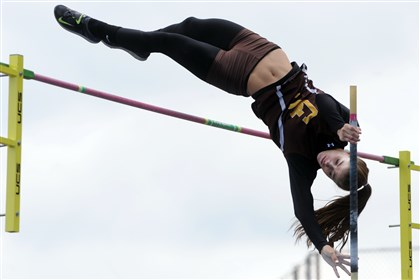 20140517ppWpialTrack3SPORTS Greensburg Salem's Courtney McQuaide clears the bar at 12 feet to win the WPIAL Class AAA girls pole vault championship Saturday at Baldwin High School.