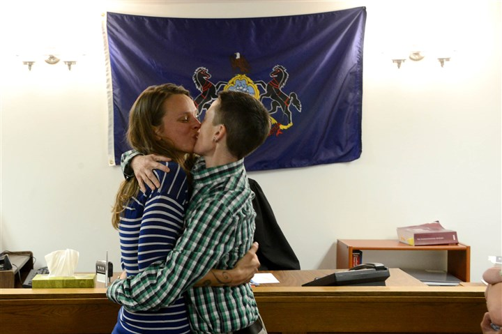 20140521MWHmarriageLocal13-9 Pamela VanHaitsma, left, and Jess Garrity, right, of Friendship, kiss Wednesday after being married before District Judge Hugh McGough at his Squirrel Hill office. The couple received their marriage license after receiving a waiver to the normal three-day waiting period from Common Pleas Judge Lawrence O'Toole.